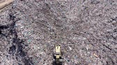aterro : Aerial top drone view of large garbage pile, trash dump, landfill, waste from household dumping site, excavator machine is working on a mountain garbage. Consumerism and contamination concept