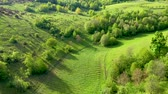 buk : Aerial 4k view of green countryside hills, meadow and forest from a drone