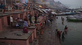 varanasi : Varanasi, India, December 2015. People bathing in a ghat on the Ganges River.