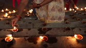 varanasi : Lighting candles in a ghat on the Ganges River.