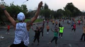 lumpini : Bangkok, Thailand, March 2016: People exercising in Lumpini Park at sunset. Stock Footage