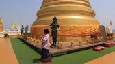 cultura thai : Bangkok, Thailand, March 2016: People walking around Wat Saket Temple, on top of Golden Mountain.