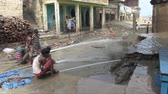 varanasi : Varanasi, India, October 2011. Cleaning the Ghats of mud after the monsoon. Stock Footage