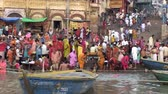 varanasi : Varanasi, India, October 2011. People bathing in a ghat on the Ganges River. Stock Footage