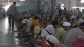 chapati : Old Delhi, India, November 2011: People eating in the dining-room at a Sikh temple in the city.