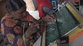 pobre : Barefoot College, Ajmer, India, January 2012. A woman works making electrical circuits for solar panels. Stock Footage