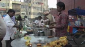 satıcı : Old Delhi, India, November 2011: Indian fast food on the street. Stok Video