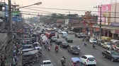 udon : Udon Thani, Thailand, February 2012: Aerial view of the street full of vehicles and people.