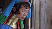 giraffe : Mae Hong Son, Northern Thailand, March 2012: Close up of a woman in the Burmese Karen refugee village known for its long-neck women.