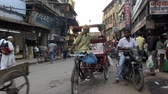 yoksulluk : Old Delhi, India, November 2011: View of the narrow streets of the city full of vehicles and people. Stok Video