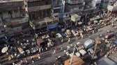 risciò : Old Delhi, India, November 2011: Aerial view of the narrow streets full of vehicles and people.