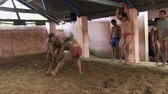 spor salonu : Old Delhi, India, June 2012: Kusthi fighters training at Guru Hanuman Akhara.