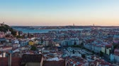 4K day to night timelapse of Lisbon rooftop from  Senhora do monte miradouro viewpoint in Portugal  UHD Stock Footage