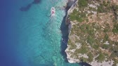 4K (UHD) Aerial view of boats mooring in  Agios Nikolaos blue caves  in Zakynthos (Zante) island, in Greece