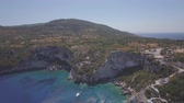4K (UHD) Aerial view of  Agios Nikolaos blue caves  in Zakynthos (Zante) island, in Greece - Log Stock Footage
