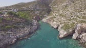 4K ungraded Aerial view of Porto limnionas beach in Zakynthos (Zante) island, in Greece - Log