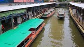 thai culture : Bangkok - Thailand, 3 Aug 2019: Pratunam pier, express boat public transport stop in center of city. Saen Saep canal. Busy traffic on Ratchadamri road