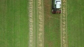 aerial footage of combine harvesting wheat