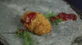 aveia : Homemade meat cutlets with parsley on stone, poured over food ketchup