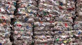 загрязнение : Piles of compressed plastic bottles prepared for recycling