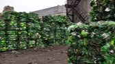 újrahasznosított : Piles of compressed plastic bottles prepared for recycling