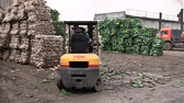 utilization : The forklift unloads the stack with extruded plastic bottles