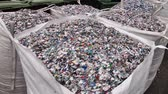 recyclable : Crushed plastic bottles in the bag prepared for recycling Stock Footage