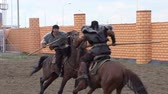 hádka : Two riders imitate medieval duel on spears. Slow Motion at a rate of 240 fps