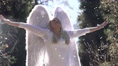 aura : Blonde girl in a white dress with angel wings backlit sunlight. In the air, floating fluff. Motion at a rate of 240 fps