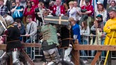 koruyucu : St. Petersburg, Russia. Spectators Enjoy Knightly Battles. Reconstruction of the traditional knight tournament. Warriors in medieval armor. Filmed at a speed of 240fps Stok Video