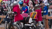 koruyucu : St. Petersburg, Russia. Knights Battle and Many Spectators. Reconstruction of the traditional knight tournament. Warriors in medieval armor. Filmed at a speed of 240fps Stok Video