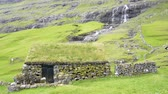 aventure : An ancient house of stones and grass in Saksun, Faroe Island