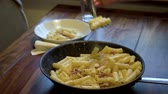 krem : Carbonara pasta served at table, lunch  dinner