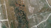 zambia : Fly over aerial view of vehicle track going into the savanna grasslands and