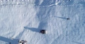 bruco : Aerial top down view of a snowcat or snow groomer on a ski resort slope in winter