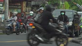 polluted : Bali street view and traffic. Busy Asian street scene with scooters - October 2017: Ubud, Bali, Indonesia