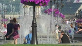 independence square : Kiev city center. Walking people in Maidan Nezalezhnosti square and fountains - June 2017: Kiev, Ukraine Stock Footage
