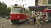 tram : Kiev cityscape, street view. Old tramcar on the street - June 2017: Kiev, Ukraine