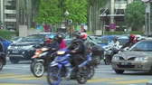 southeast asia : Kuala Lumpur traffic. Busy street scene. Lot of cars and scooters - October 2017: Kuala Lumpur, Malaysia Stock Footage
