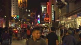 fama : Crowd of people in Hollywood blvd. at night. Walk of fame - August 2017: Los Angeles California, US Vídeos