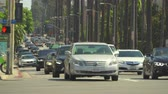 california landscape : Heavy traffic in the street. Crescent dr, Beverly Hills - August 2017: Los Angeles California, US Stock Footage
