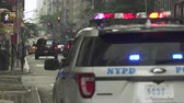terrorist : Flashing police car in 5th avenue - August 2017: Manhattan, New York City, NY, US Stock Footage