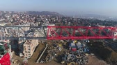 scaffolding : Aerial view of crane in the construction site. Aerial shot of tower crane - March 2018: Budapest, Sasad, Hungary