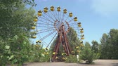 катастрофа : Abandoned amusement park, ferris wheel in Pripyat. Chernobyl nuclear disaster 30km Chernobyl, exclusion zone