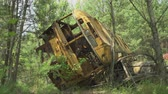 wrack : Rusty bus wreck in the forest in Pripyat. Chernobyl nuclear disaster. Slider shot 30km Chernobyl, exclusion zone Stock Footage