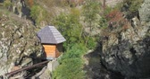 turn over : Aerial view of water mill building in mountains - Transylvania, Romania Stock Footage