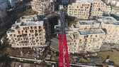 andaime : Aerial view of crane in the construction site. Aerial shot of tower crane