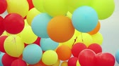 red center : Lot of colorful balloons in the air Stock Footage
