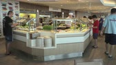 display case : Self service restaurant interior. Buffet food on the counter.
