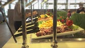 display case : Food in a display warmer in a self-service restaurant. Hands in the display case